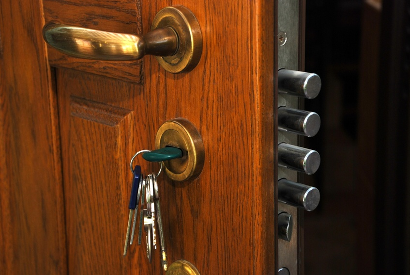 close-up safe lock in the open home wood door